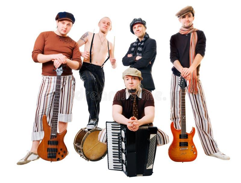 Musikalisches Band mit ihren Instrumenten auf Weiß stockfoto