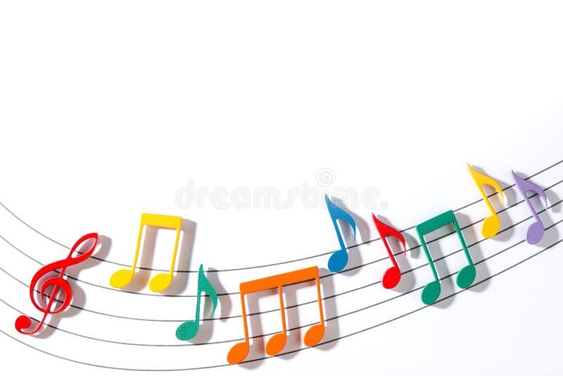 Musikaliska anmärkningar för färg royaltyfria bilder