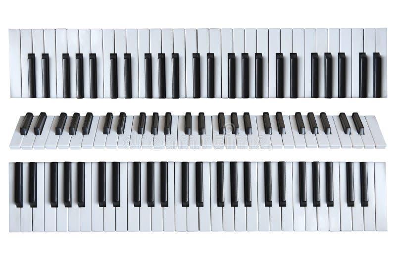 Musikaliska tangenter på den vita isolerade bakgrunden fotografering för bildbyråer