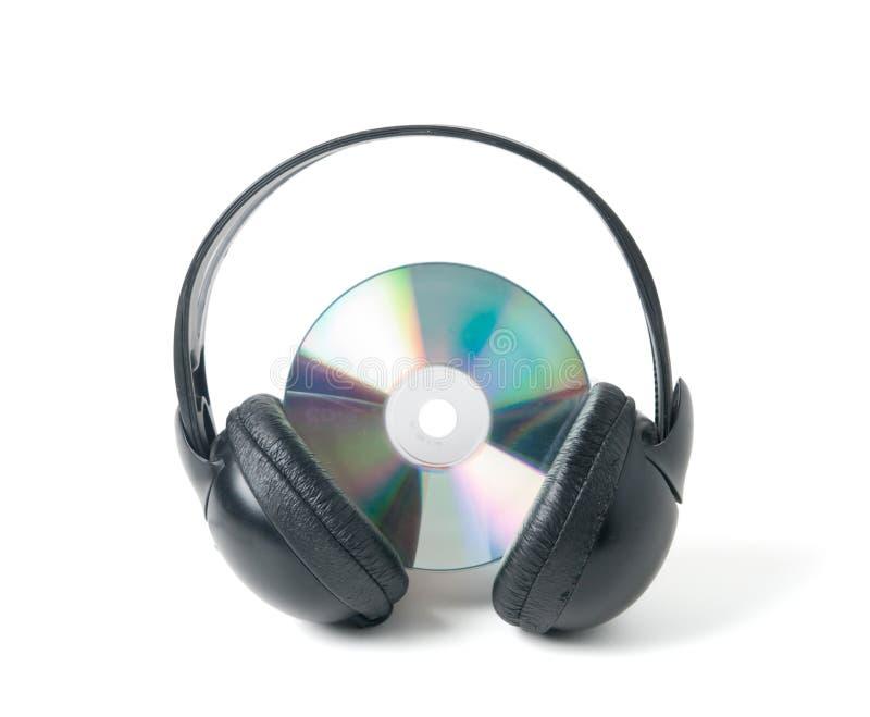Musikcd und -kopfhörer lizenzfreies stockbild