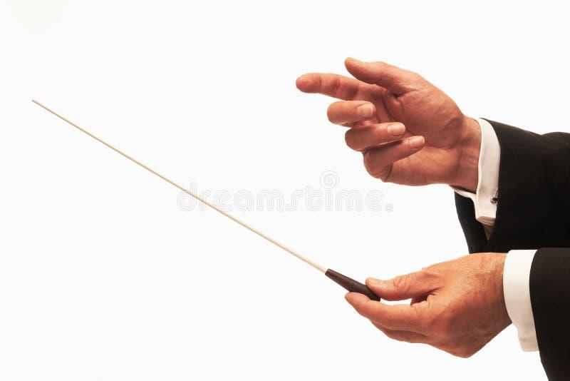 Musikleiterhände mit Taktstock lizenzfreie stockfotos