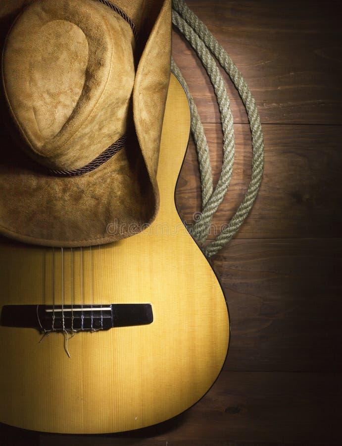Musique country avec la guitare sur le fond en bois photo stock