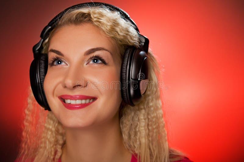 musique de écoute au femme image libre de droits