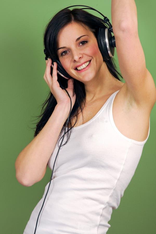 Musique de écoute de femme photo libre de droits