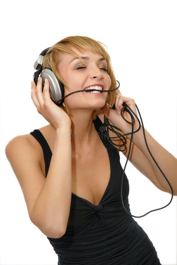 Musique de écoute de fille images libres de droits