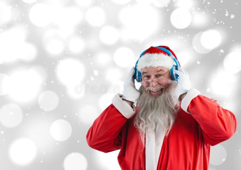 Musique de écoute de Santa sur des écouteurs image libre de droits