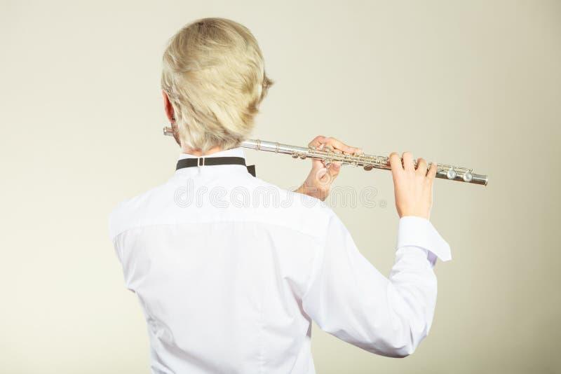 Musique de cannelure jouant l'interprète de musicien de flûtiste photos stock