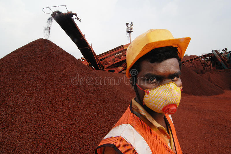 The Musk Protection. June 07,2013 Barbil,Orissa,India,Asia-A manual labour wearing a musk for dust protection at the iron mines in Orissa-India royalty free stock photography