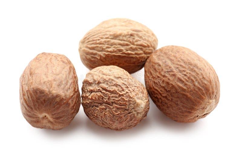 Muskatnuts auf wei?em Hintergrund stockbilder