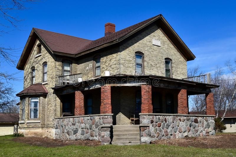 Muskego Italianate. This is a Spring picture of a brick and stone house located in Muskego, Wisconsin. This house built in 1881 is an example of Italianate royalty free stock images