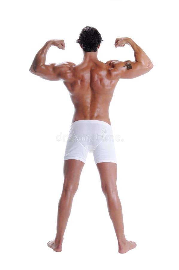 Muskel-Mann in den Boxer-Schriftsätzen lizenzfreie stockfotos