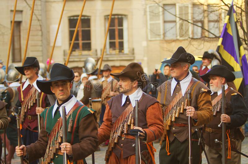 Musketeers with Arquebuse. Musketeers in traditional clothing armed with arquebuse during the celebration of the Escalade in Geneva, Switzerland