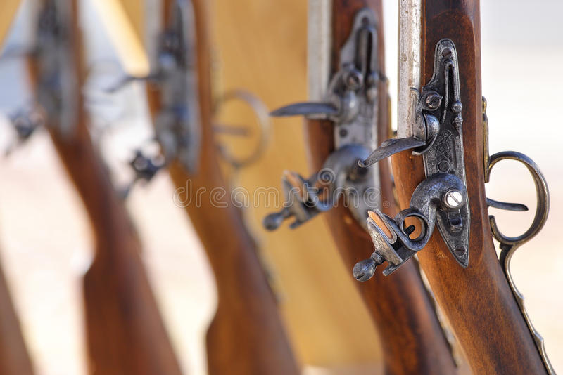 Muskets Civil War. Civil War muskets aligned in a gunsmith royalty free stock photo