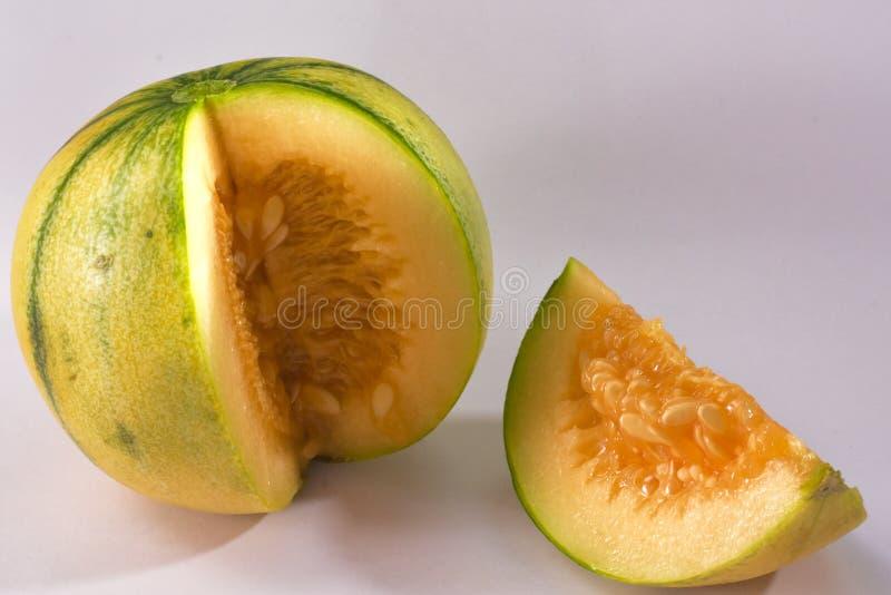 MUSKMELON YELLOW GREEN TEXTURE FRUIT. FRESH HEALTHY NUTRITIOUS stock image