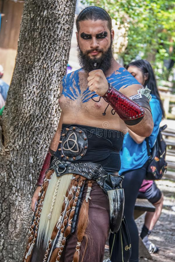 2019 -06-02 Muskogee USA Man dressed as Khal Drogo from Game of Thrones with hand clenched and band around his arm holding tips stock image