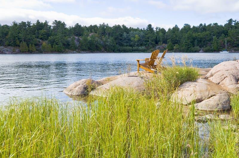 Download Muskoka Chairs On A Big Rock Stock Photo - Image: 11009170