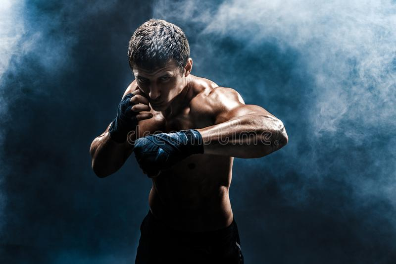 Muskulös topless kämpe i boxninghandskar royaltyfria foton