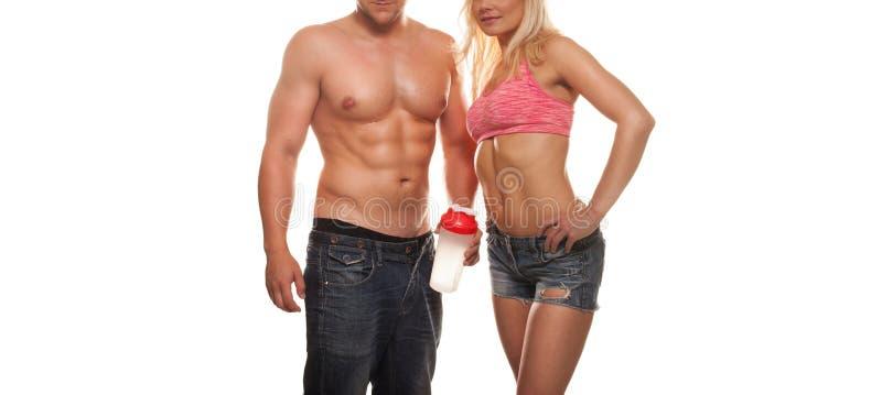 Muskulösa sexiga par som utarbetar arkivfoton