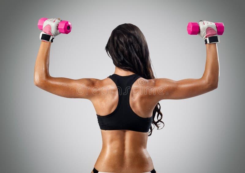 Muskulöse Fraurückseite lizenzfreies stockbild