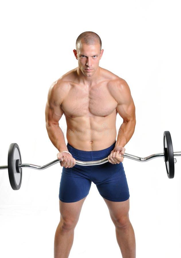 Muskulöse Mannübung auf einem weißen Hintergrund lizenzfreies stockbild