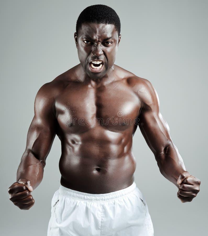 Muskulöser schwarzer Mann stockbilder