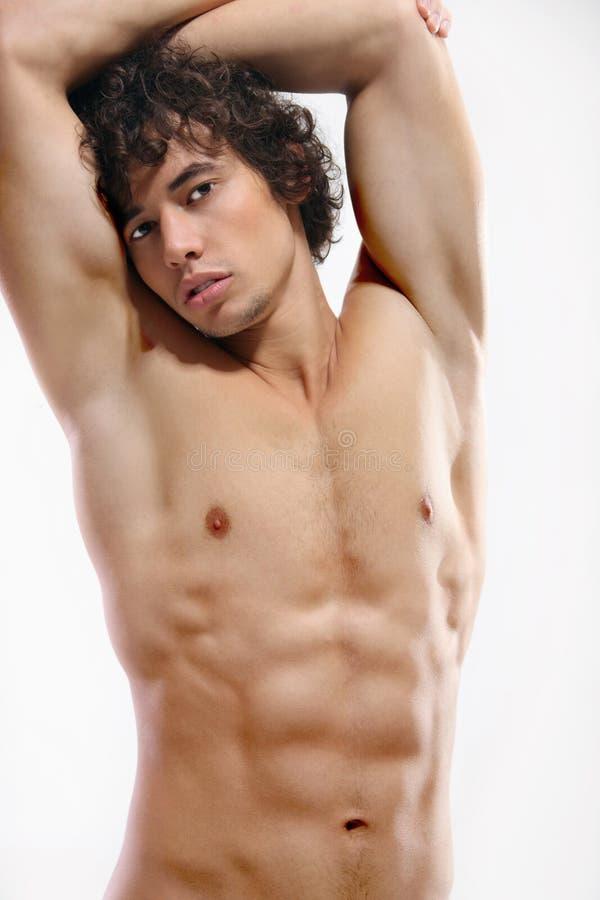 Muskulöses männliches Baumuster lizenzfreie stockbilder