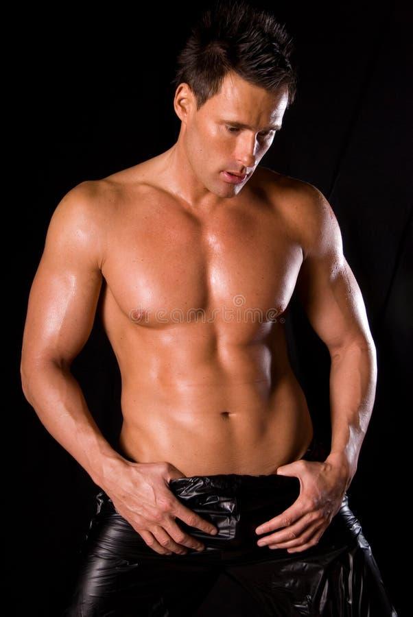 muskulöst sexigt för man royaltyfri fotografi