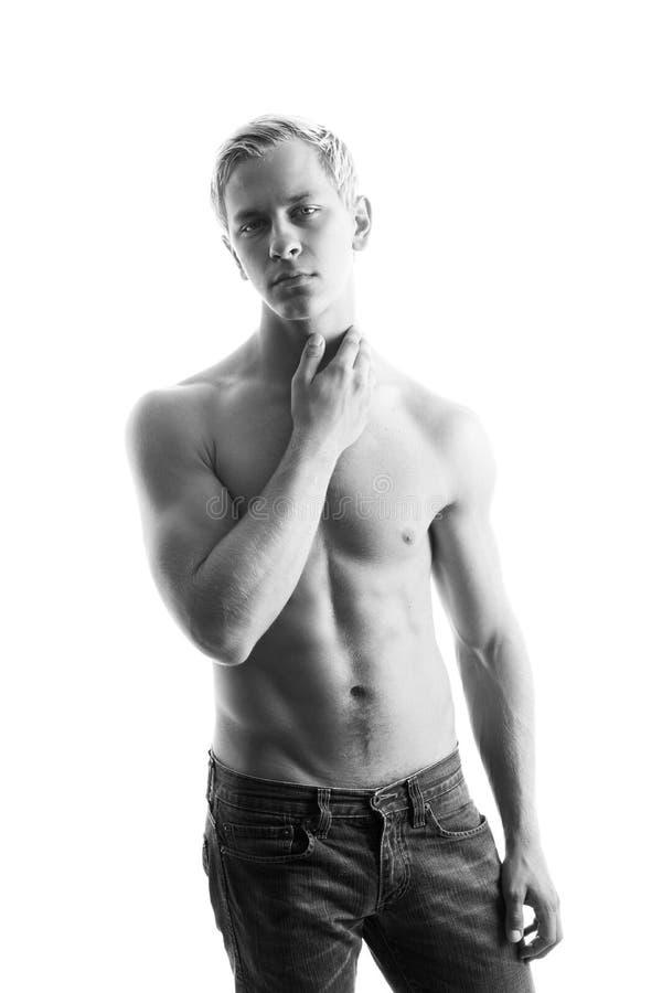 muskulöst sexigt shirtless för man arkivbilder
