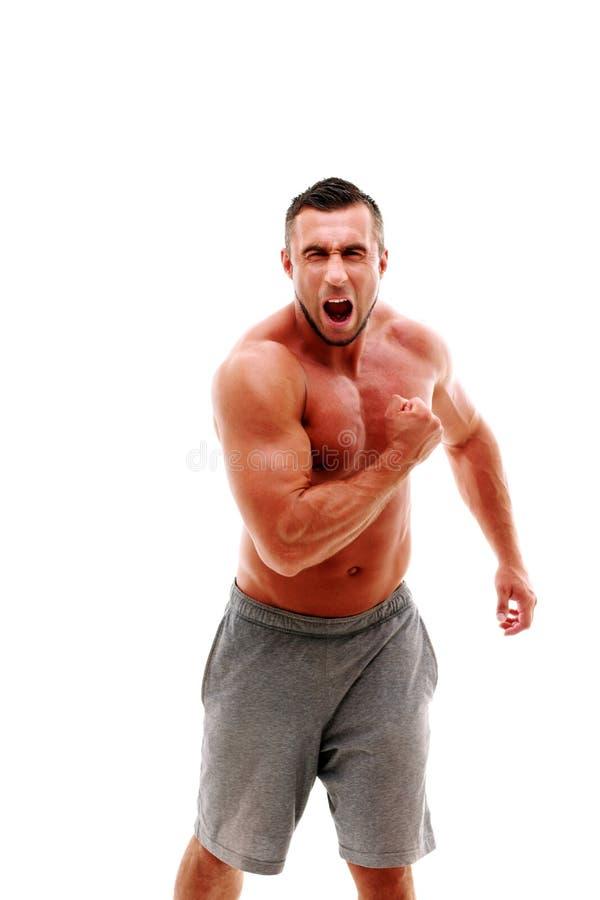 Muskulöst shirtless idrotts- skrika för man arkivfoton