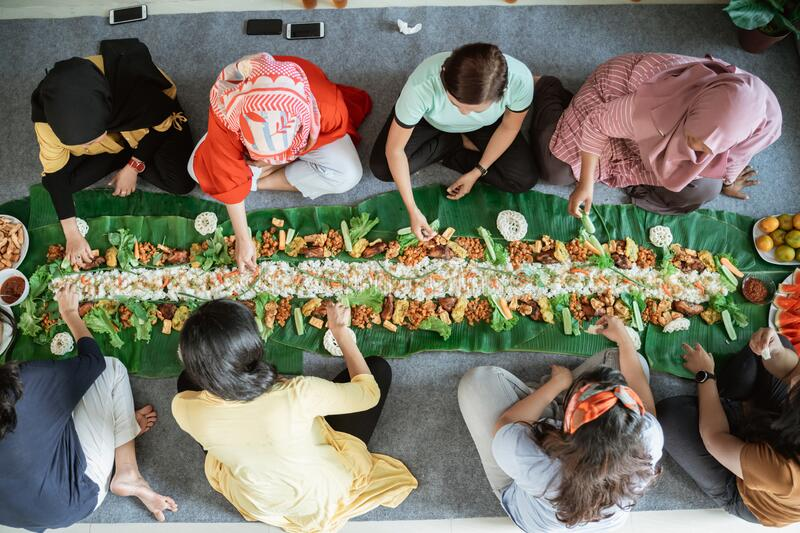 Asian woman social gathering at home having lunch stock photography