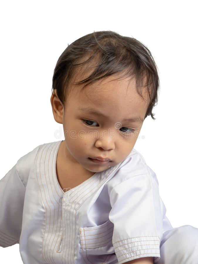 Muslim boy in a dress , isolate background royalty free stock image