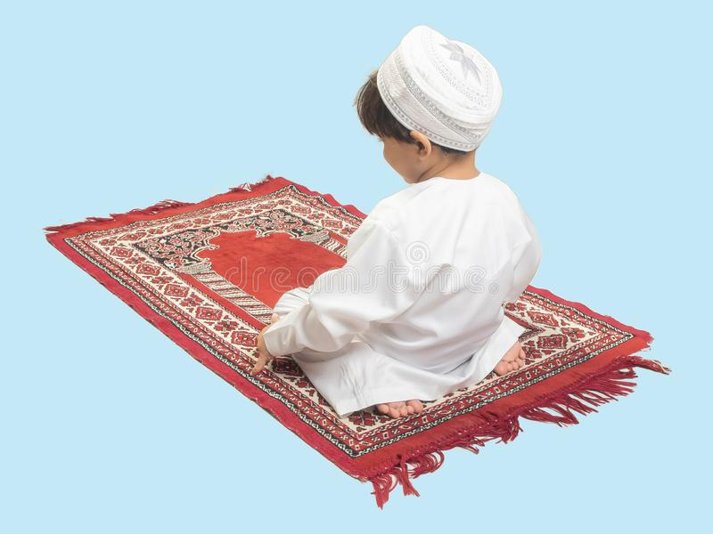 Muslim boy in a dress Praying , isolate background.  stock photos
