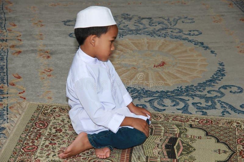 Muslim boy praying stock images