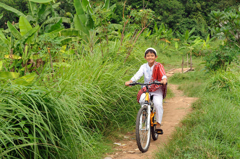 Muslim Boy Riding Bicycle stock images