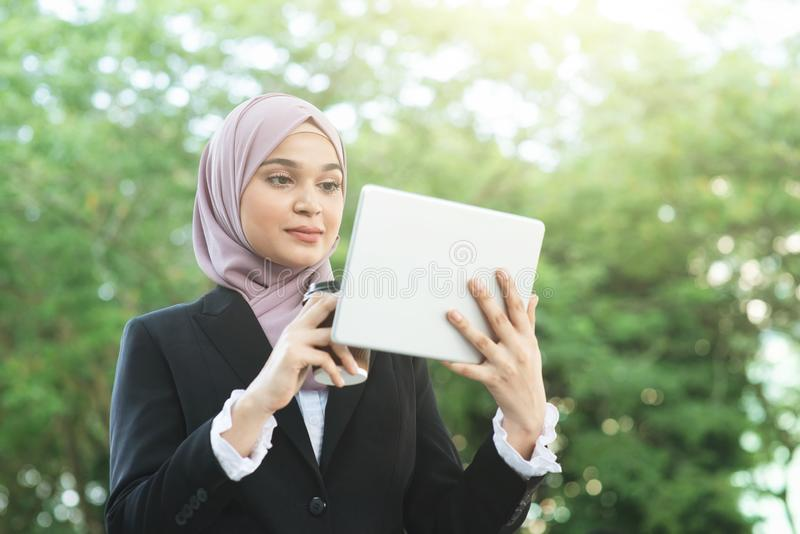 Muslim business woman going to work royalty free stock images