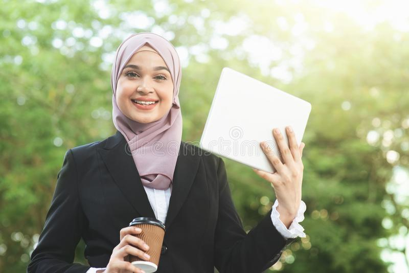 Muslim business woman going to work stock photography