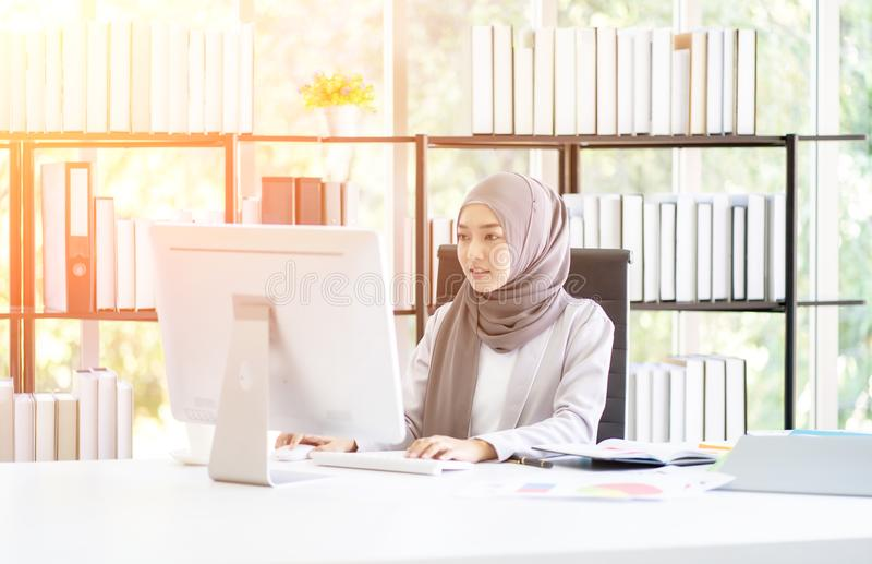 Muslim Business Woman in Hijab with Documents at Workplace in Office royalty free stock photos
