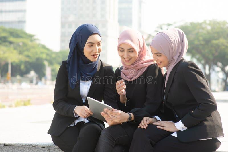 Muslim business women discussing stock photos