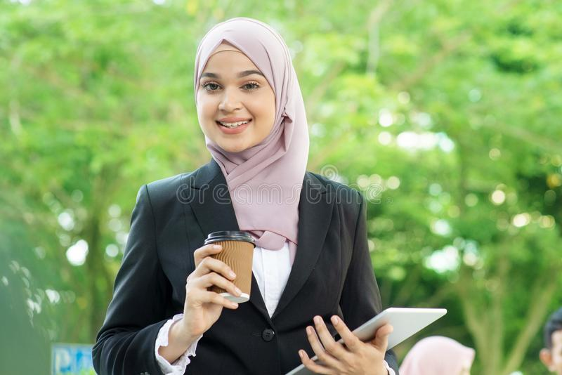 Muslim business woman going to work stock photo