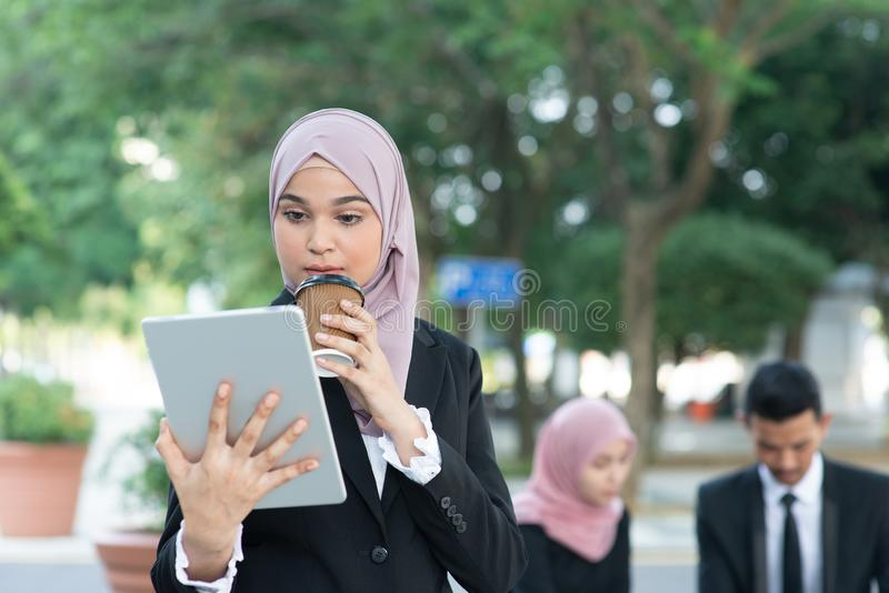 Muslim business woman going to work stock photos
