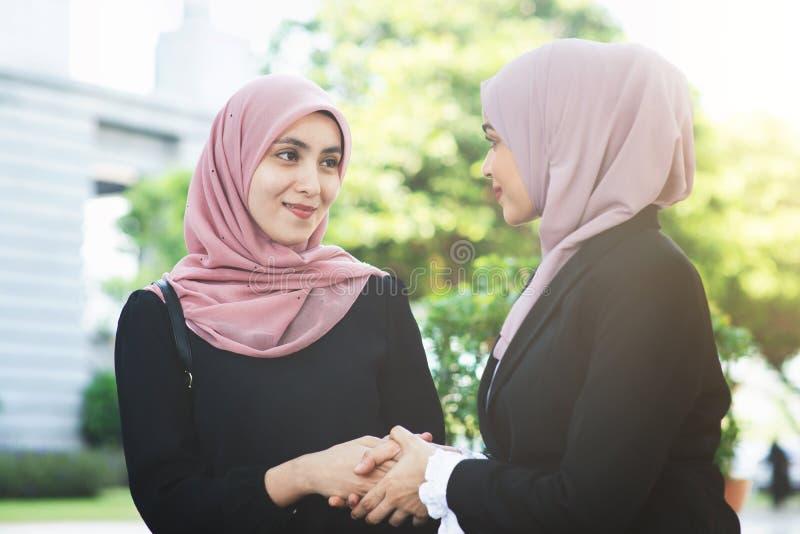 Muslim business women greeting stock image