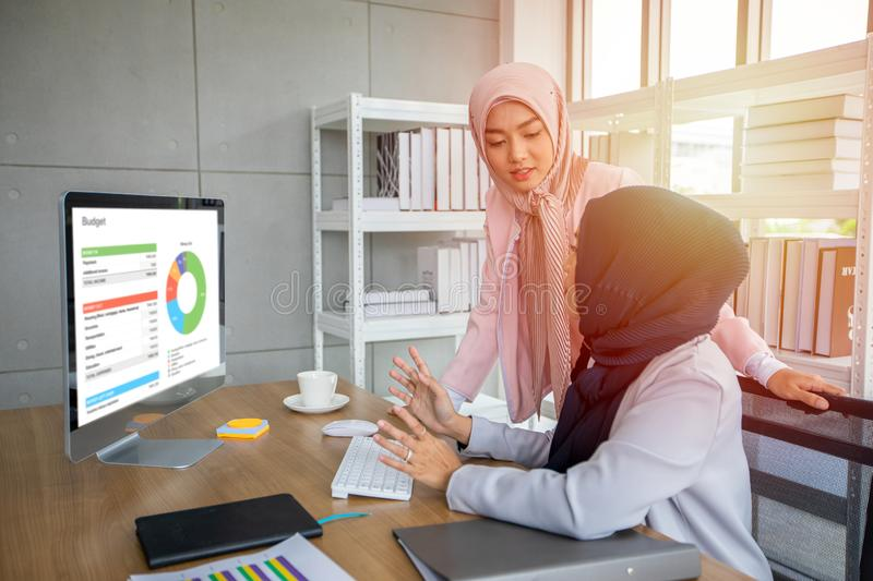 Muslim business woman in traditional clothing working and discussing at meeting in office stock images