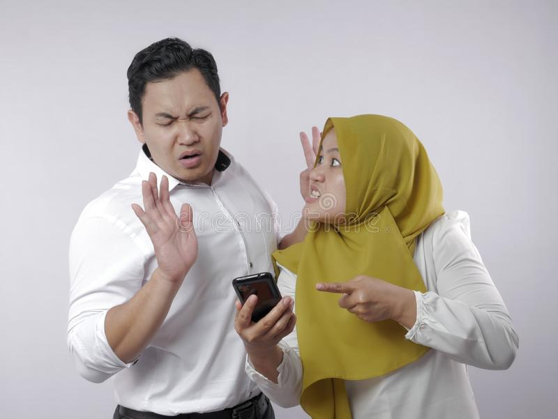 Muslim Couple Having Fight, Angry Wife Find Her Husband Cheating on Phone stock photo