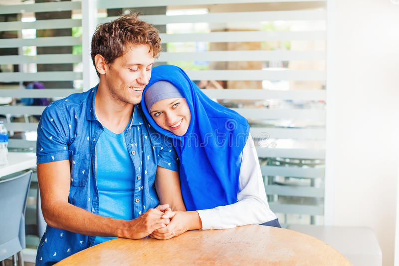 Muslim couple in love at home stock photos