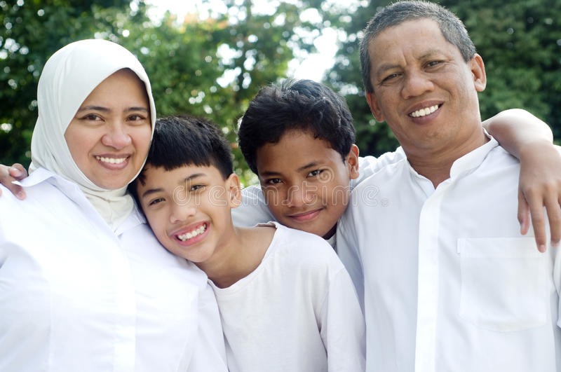 Muslim family. Outdoor portrait of muslim family