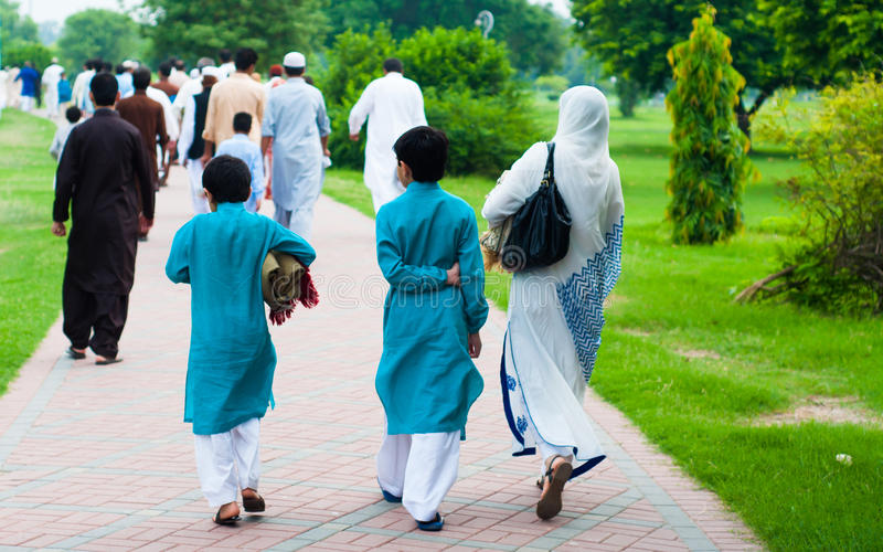 Muslim family going for Eid prayers, Lahore, Pakistan stock images