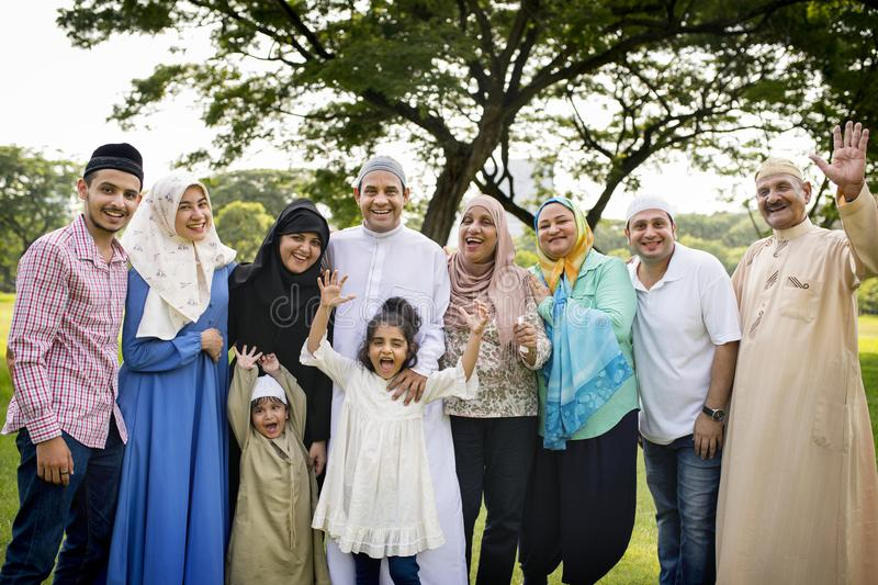 Muslim family having a good time outdoors stock photography