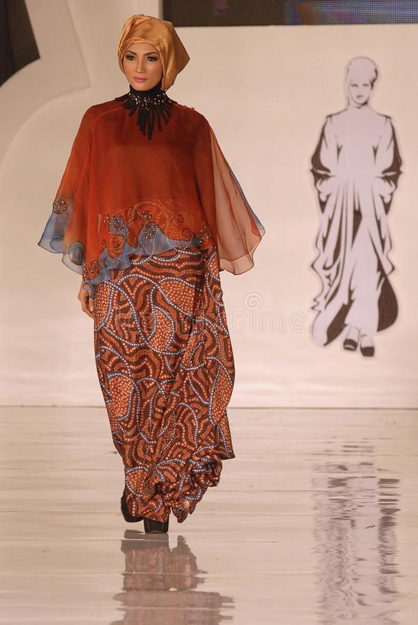 Muslim Fashion Festival 2014. A model showcases designs by Alphiana Candrajani on the runway at the 5th Muslims Fashion Festival 2014 show on October 3, 2014 in royalty free stock images