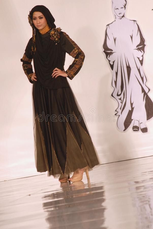 Muslim Fashion Festival 2014. A model showcases designs by Alphiana Candrajani on the runway at the 5th Muslims Fashion Festival 2014 show on October 3, 2014 in royalty free stock image