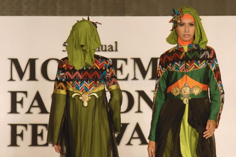 Muslim Fashion Festival 2014. Models showcase designs by Lia Afif on the runway at the 5th Muslims Fashion Festival 2014 show on October 3, 2014 in Surabaya stock image